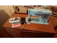 Singer sewing machine with built in cupboard