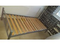2 single metal framed beds