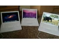 Three Apple macbooks