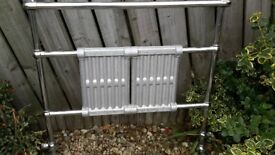 Heated radiator/towel rail. 97cm wide, 94cm high.