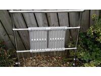 Heated radiator/towel rail. 97cm wide, 94cm high.