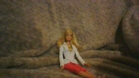 Barbie in outfit.