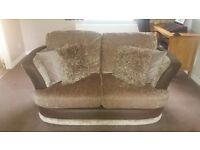 2 piece suite which includes a sofa bed in the 3 seater. Good condition and only 5 yesrs old