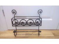 Small, decorative metal shelf