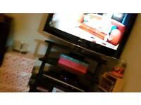 Black 4 tier corner tv stand