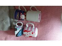 4 Mugs for anyone who wants. 2 Disney, 1 percy pig, 1 cadbury