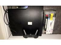 PS3 320GB for sale with 4 games