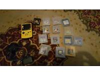 Nintendo game boy pokemon edition with 14 games charger and a case.