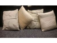 Four cream pillows
