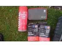 Boat safety flares air horns and first aid kit
