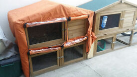 Two Rabbit hutches or suitable for guinea pigs.