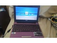 Asus purple Notebook.. Charger included