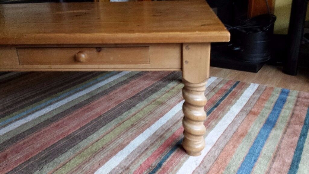 Large, solid wood coffee table; W 152 cm D 91 cm H 49 cm. £60