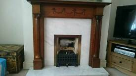 Marble fireplace and wood surround