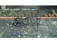 wrought iron wheel barrow
