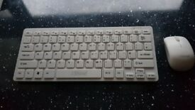 White brand new wireless keyboard and mouse