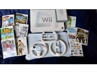 A boxed Wii with games