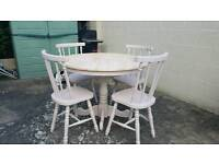 Gorgeous upcycled solid wood table and 4 chairs.