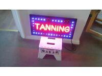 Tanning sign