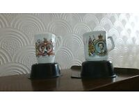Charles and Diana wedding mug and Queen silver jubille mug.