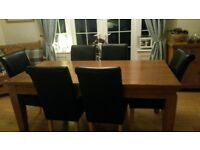 oak dining table and 6 brown leather chairs