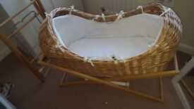 Moses basket includes 2 stands £30 ono.