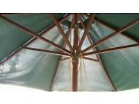 Large green garden parasol with base