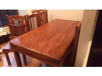 Solid wood dinning table and six chairs. In great condition