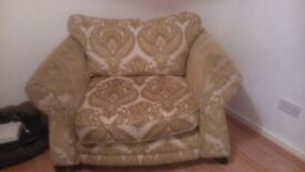 3 seater sofa and cuddle chair in green. Really good condition. looking for quick sale. .