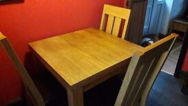 Next extendable solid oak table & 4 oak & faux leather chairs. Cost £800 new