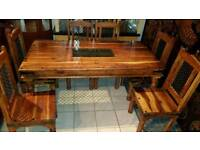Lovely brown solid wood dining table and 6 chairs,