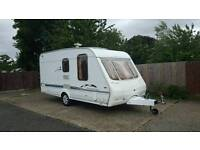 2002 swift charisma 235 2/3 berth caravan with rear bathroom and awning all accessories