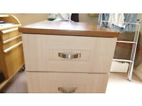 Two bedside cabinets H75cm W59cm D55cm, H75cm W44cm D22cm small chip on smaller soft close drawers.
