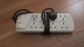 Computer multiplug with power surge protection