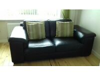 Natuzzi Black leather settees