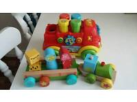 2 baby toys vehicles, wooden and Vtech