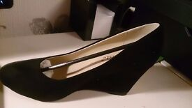 Black wedge shoes brand new in box size 3 never been on as ordered wrong size