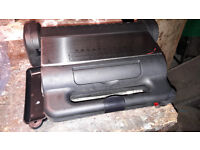 Small electric grill / sandwich toaster.
