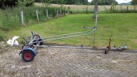 Boat trailer and launch trailer