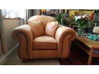 Thomas Lloyd tan leather armchair with two coshions and large pouffee. Can Deliver!