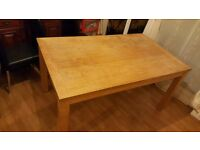 Sturdy and clean oak dining table.