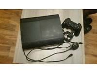 PS3 super slim with wireless controller and charger and 3 games
