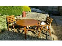 Teak table and two chairs