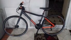 Hybrid mountain bike, as new condition hardly used. 18 inch aluminium frame.