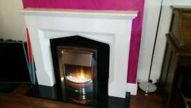 Real stone surround, chrome electric fire with black marble hearth, all included