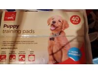 TWO BOXES OF PUPPY TRAINING PADS + ++++