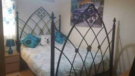 Wrought iron gothic style double bed