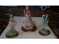 3 Figurines with wooden bases