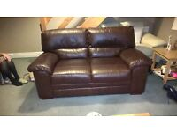 Pair of brown leather sofas. 2 & 3 seater. £175 ono.