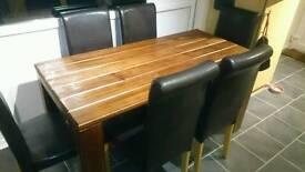 Handmade solid mahogany dining table